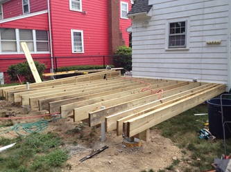 remove all existing decking railings and steps build new steps and custom landing trim out entire deck frame and install trex decking and railing